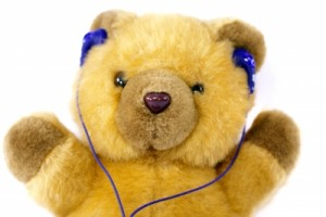 TED Talks about words: teddy bear with headphones