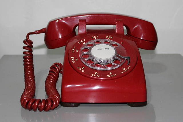 Red rotary dial telephone